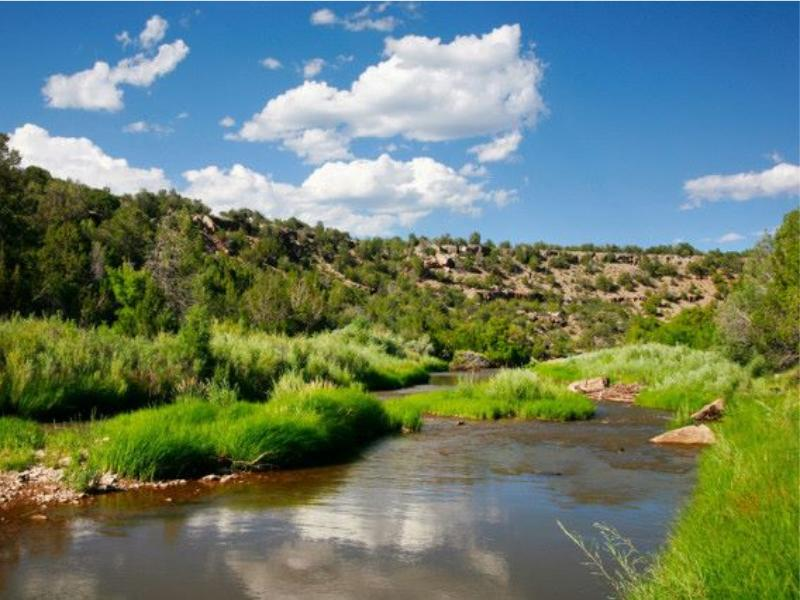 Creek Ranch NM features sweeping views of sun-splashed terrain, the red desert landscape filled with huge arroyos and canyons