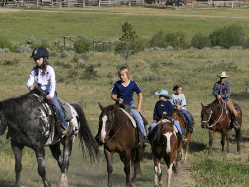 Family horseback riding at Montana's Elkhorn Racnh