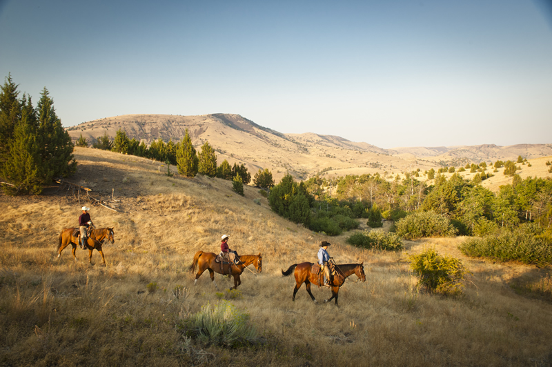 Enjoy a horseback ride at Wilson Ranches Retreat in Fossil, Oregon