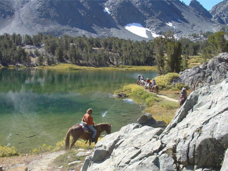 Hunewill Guest Ranch Horseback riding in mountainous Bridgeport Valley of California