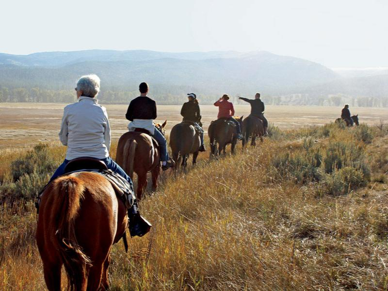 Horseback riding at Montana's The Resort at Paws Up