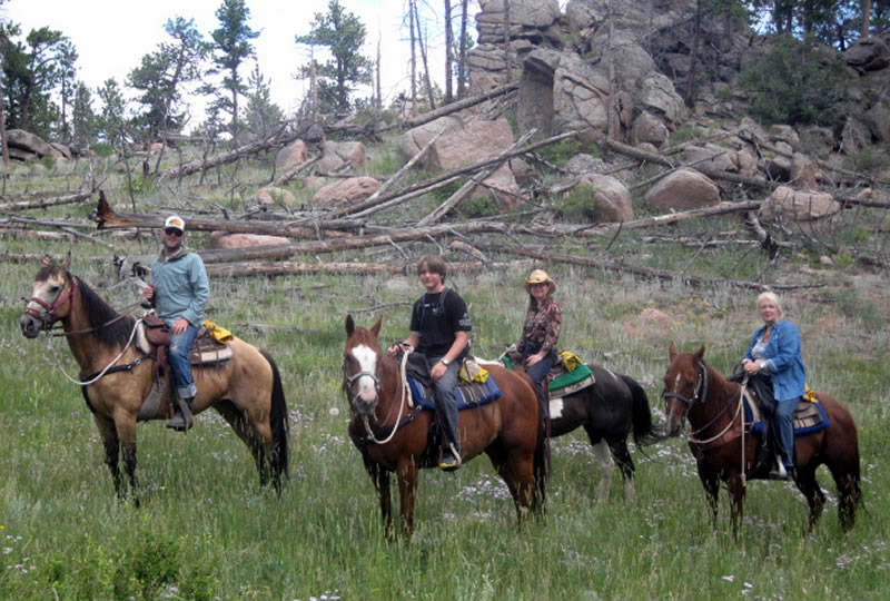 Horseback riding at Sundance Trail Ranch in Red Feather Lakes, Colorado