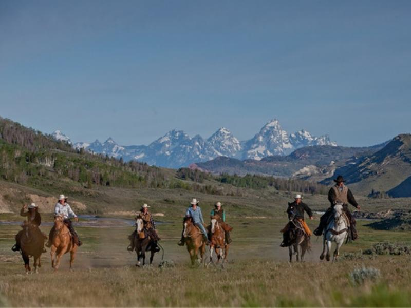 Horseback riding deep in the Gros Ventre River Valley of Wyoming with Goosewing Ranch
