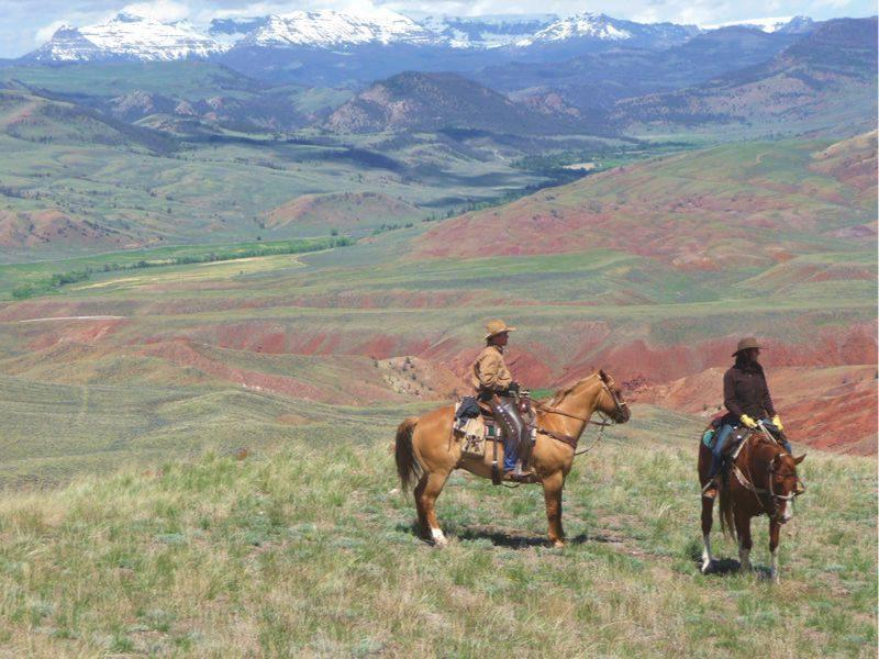 Horseback riding in Wyoming's red clay cliffs of three mountain ranges at Lazy L&B Ranch