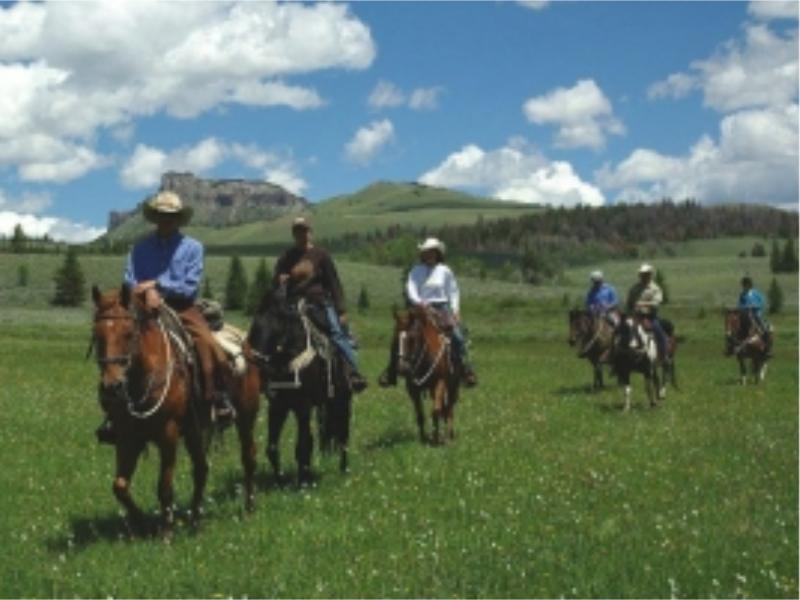 Horseback riding in Wyoming's mountain ranges at Lazy L&B Ranch
