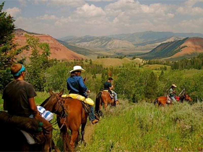 Horseback riding at Red Rock Ranch located in the Bridger Teton National Forest, Wyoming